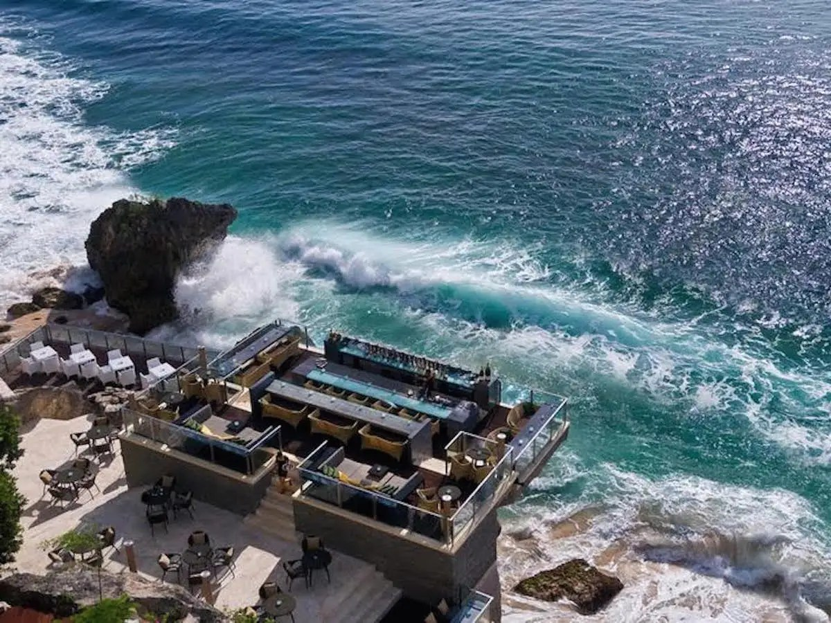 Rock Bar in Kuta, Bali,iscarved into a cliff face and overlooksthe Indian Ocean from a rocky perch 46 feet above crashing waves. Even better than sitting on the water? Having to take a four-person cable car to get there.