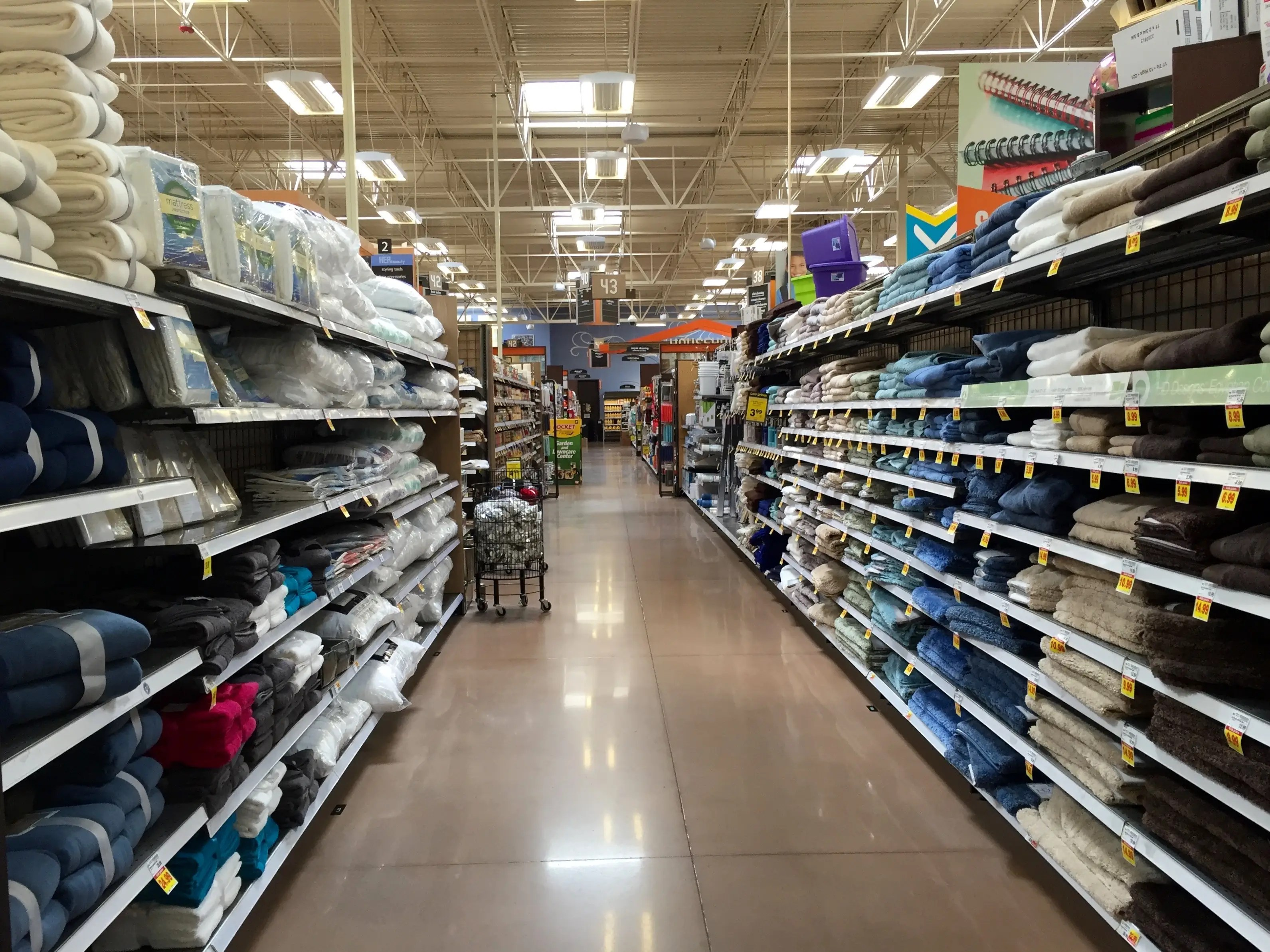 One aisle is devoted to towels and bathroom accessories, such as soap dispensers and trash cans.