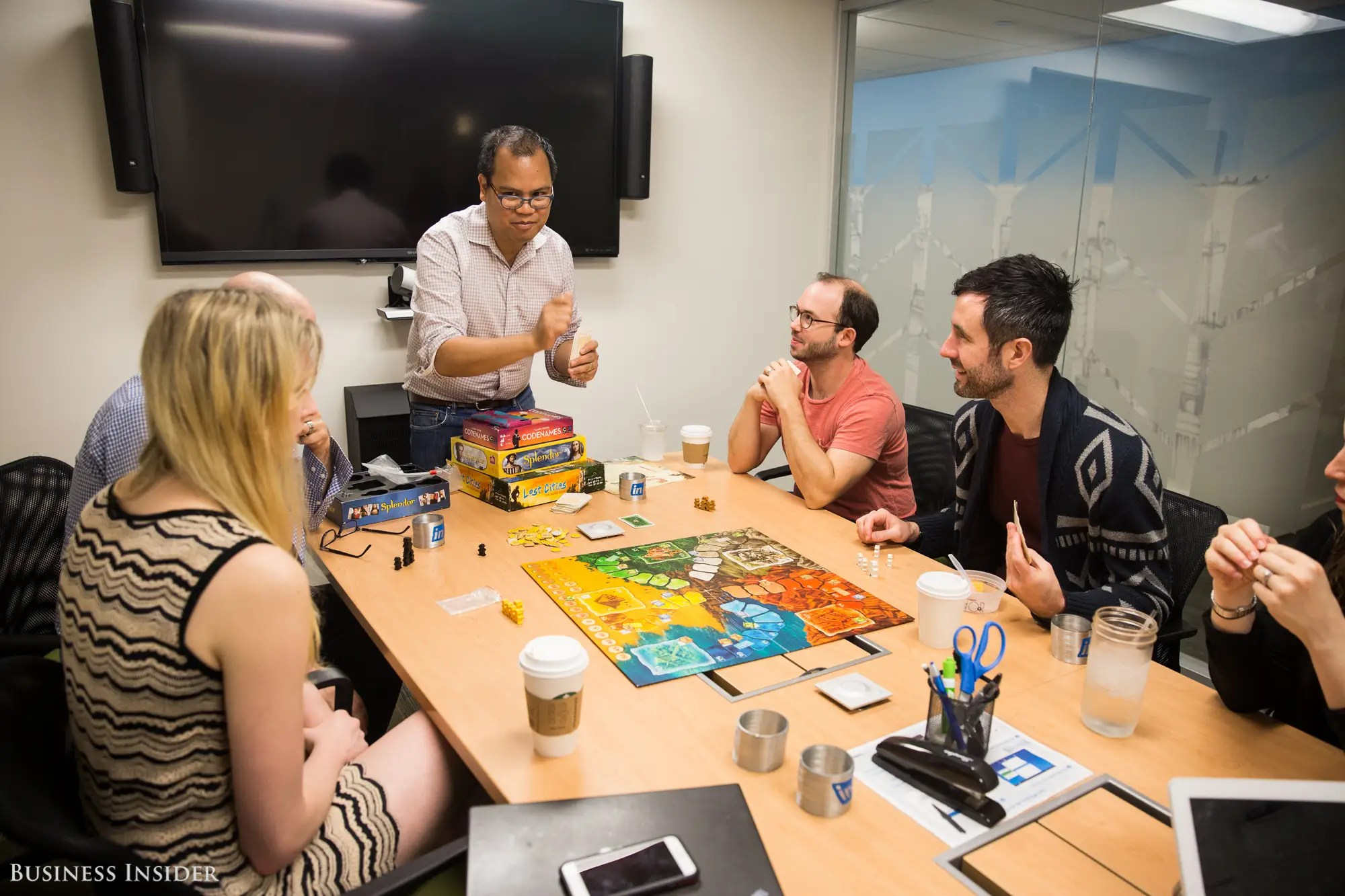 """We visited LinkedIn on a what they call an """"InDay"""" — a monthly event that offers LinkedIn employees the chance to participate in different activities and team-building exercises. Here, a group of workers are enjoying an intense game of """"Lost Cities."""""""
