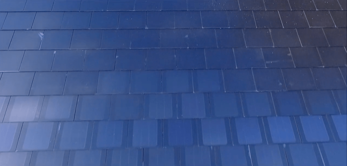 Unlike the textured glass tile and French slate offering, the smooth glass tile seen here was purposefully designed so you could see the solar cells from certain angles.
