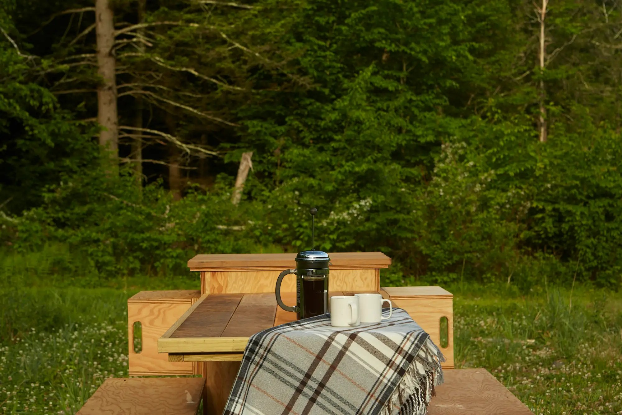 A picnic table provides even more storage in the hollowed out benches.