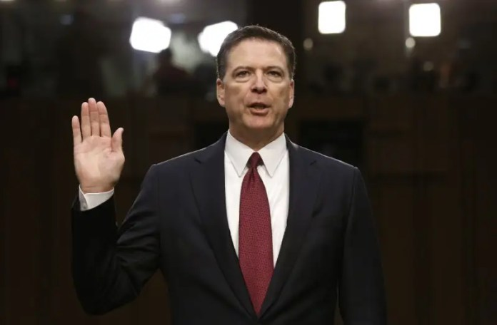 FILE PHOTO: Former FBI Director James Comey is sworn in prior to testifying before a Senate Intelligence Committee hearing on Russia's alleged interference in the 2016 U.S. presidential election on Capitol Hill in Washington, U.S., June 8, 2017. REUTERS/Jonathan Ernst Trump calls Comey's treatment of Clinton email probe 'obviously a fix' Trump calls Comey's treatment of Clinton email probe 'obviously a fix' house panel to consider measure seeking comey firing documents 2017 9