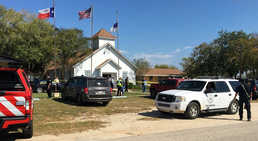 Emergency personnel respond to a fatal shooting at a Baptist church in Sutherland Springs, Texas, Sunday, Nov. 5, 2017. (KSAT via AP