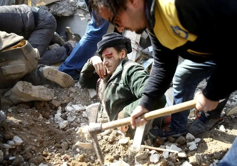 A Picture And Its Story Syrian Pulled From Rubble Mourns