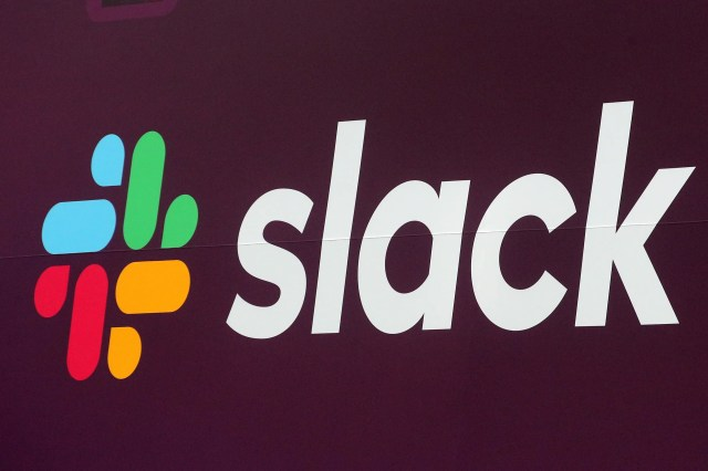 The Slack Technologies Inc. logo is seen on a banner outside the New York Stock Exchange (NYSE) during thew company's IPO in New York, U.S. June 20, 2019.  REUTERS/Brendan McDermid