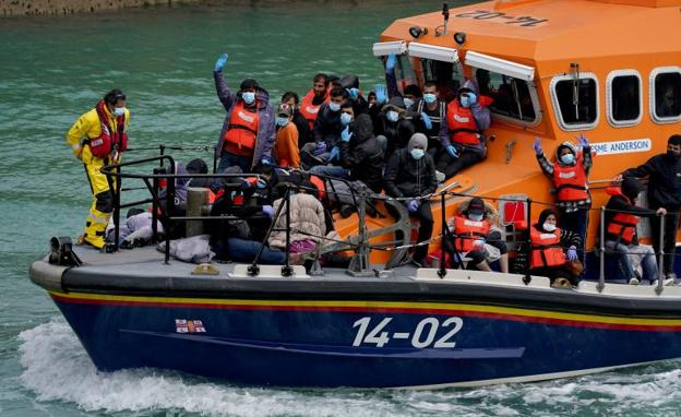 A boat arrives at the port of Dover with immigrants rescued in the English Channel.
