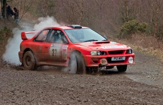 Red Subaru Power Sliding with Smoke