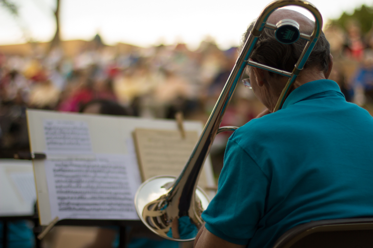 Bill Finch, Pueblo Munical Band member warms up prior a Sunday evening performance.