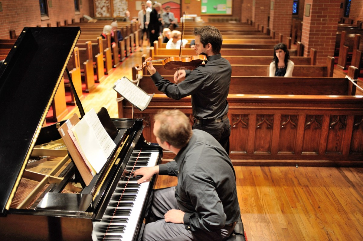Zahari Metchkov and Geoffrey Herd rehearse before the concert at Ascnecion Church. (Courtesy Zahari Metchov)