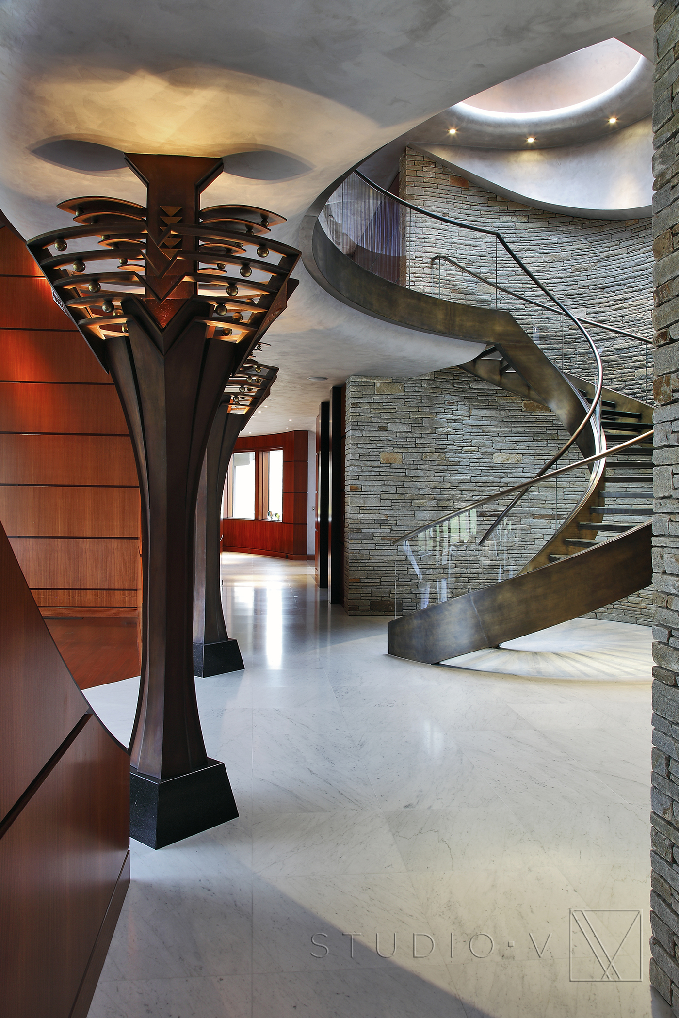 8403 Studio V Interiors Scottsdale AZ Arizona Top Interior Design     02 Foyer Spiral Staircase Studio V Interiors Scottsdale AZ Greenwich CT jpg