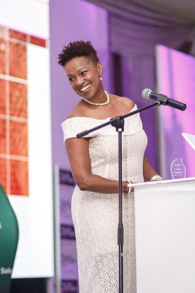 Brandbuilder founder receiving influencer award at #zimwomenroar.jpeg