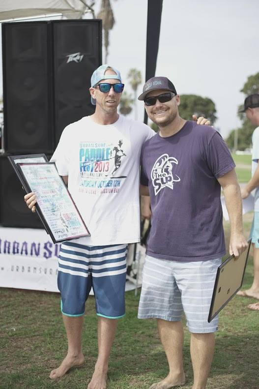 Wes giving Jeton a thank you framed and signed poster for The SUP Connections contributions to the event.