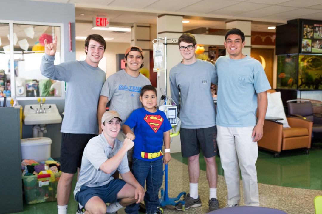 Ben Norton, Evan Amann, Ricky Martinez, Alex Dieste, and Tim Davis pictured with B+ Hero Nicholas