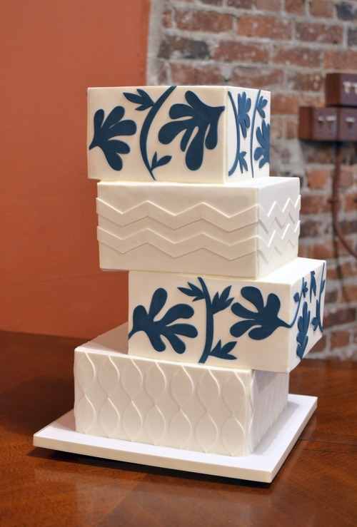 Custom Wedding Cakes     Honey Crumb Cake Studio   Seattle Bakery     Cantilevered square wedding cake with Jonathan Adler inspired appliqu      designs  Image      Carla Schier