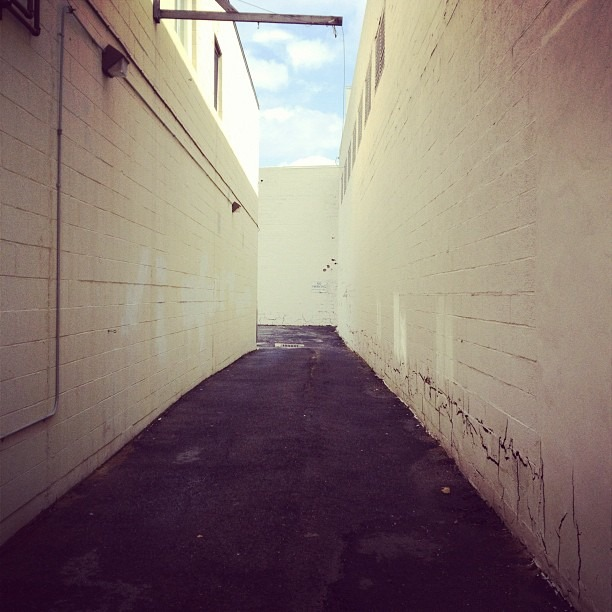 There's cracks and emptiness down every alley. (Taken with Instagram)