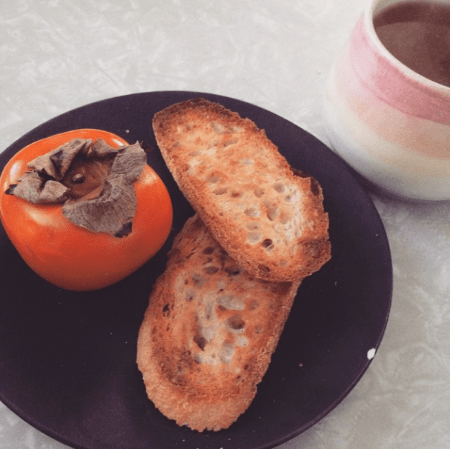 A persimmon. Rosemary toast. Tea with honey. Handmade crockery. This is all totally doable.