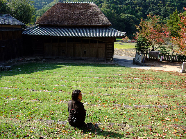 Sitting outside a farm village Kabuki theater on Shodoshima Island