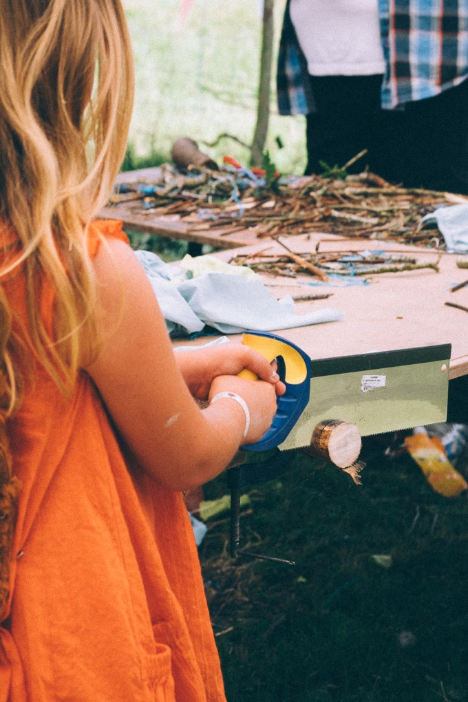Child working with tools, NAtional Trust 50 things meadow Camp Bestival 2015