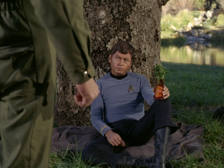 Dr. McCoy is enjoying a beverage.