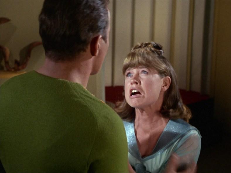 Kirk comforts someone.