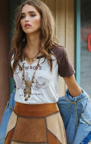 WHITE CROW Cowboys Are My Weakness Tee. Another pick from 27 Boutique, this tee has Stampede style written all over it! It could be paired with jeans or a denim skirt or shorts, and how great does it look with gold jewelry?!