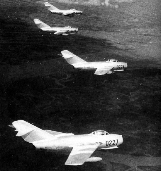A flight of MIG-15's over North Korea. Source