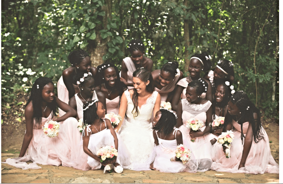 Katie Davis Majors on her wedding day with her daughters who were her bridesmaids