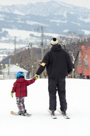 A young participant helping our instructor down after a long day on the slopes.