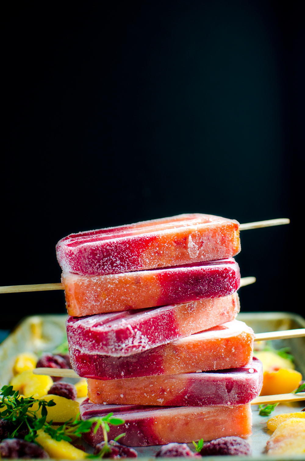 Peach Melba Popsicles (Thyme, Peach, and Raspberry) via The Flavor Bender