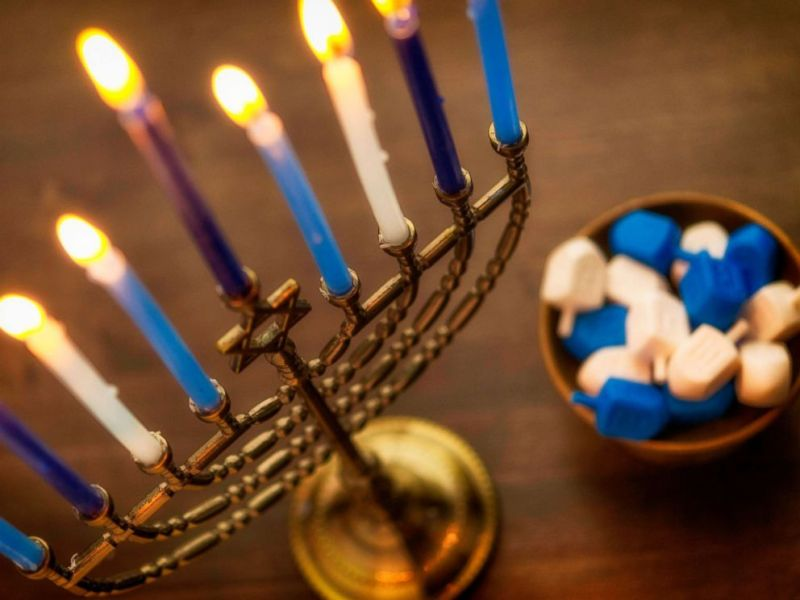 Menorah with burning candles and dreidel. What you need to know about Hanukkah ByLINDSEY JACOBSON. Nov 27, 2018, 11:21 AM ET