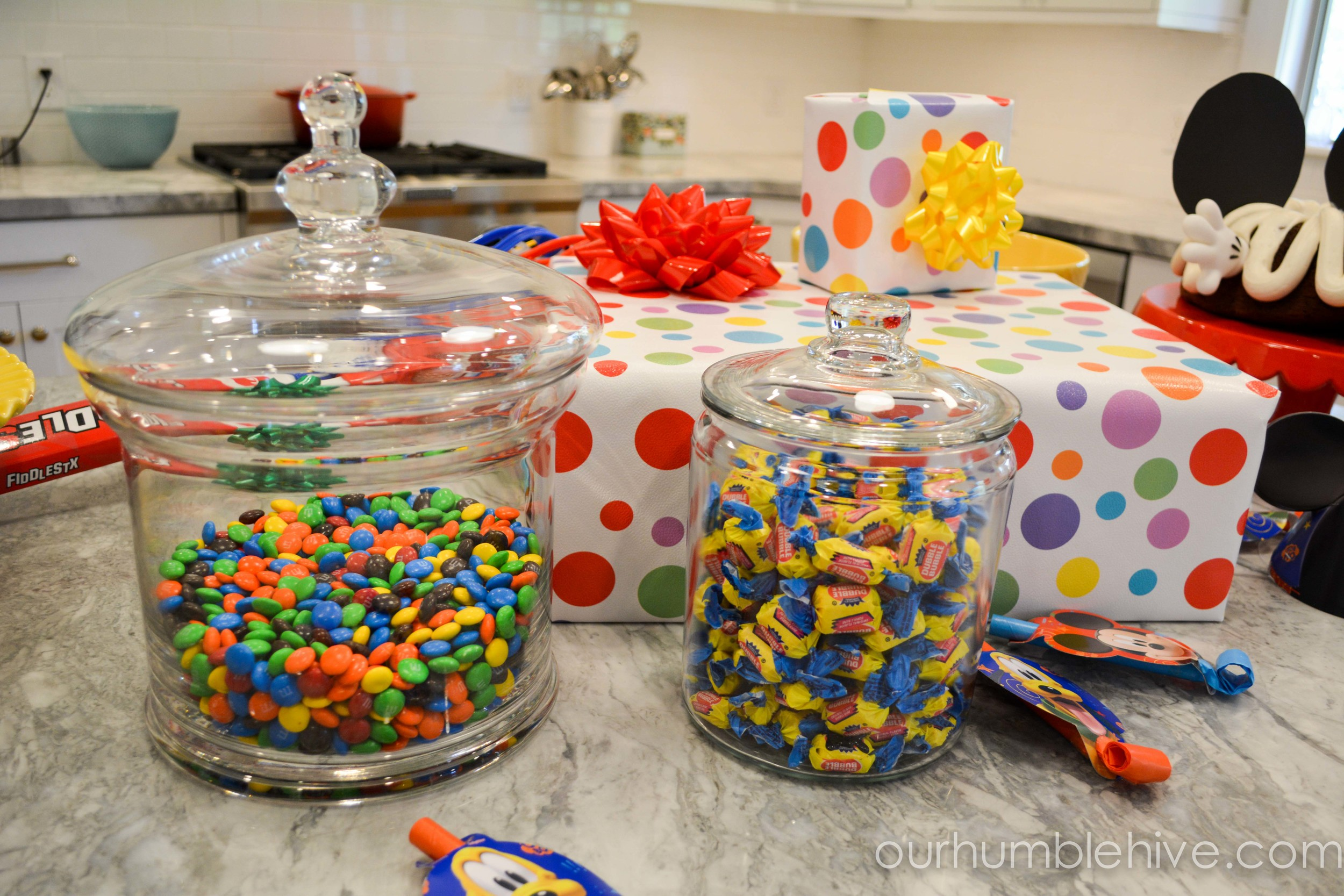 Simple and Inexpensive Birthday Party Decor Tips and Tricks     Our     Another simple and functional way to decorate is using glass jars full of  candy  Not only can your party guests enjoy munching on their favorite  candy