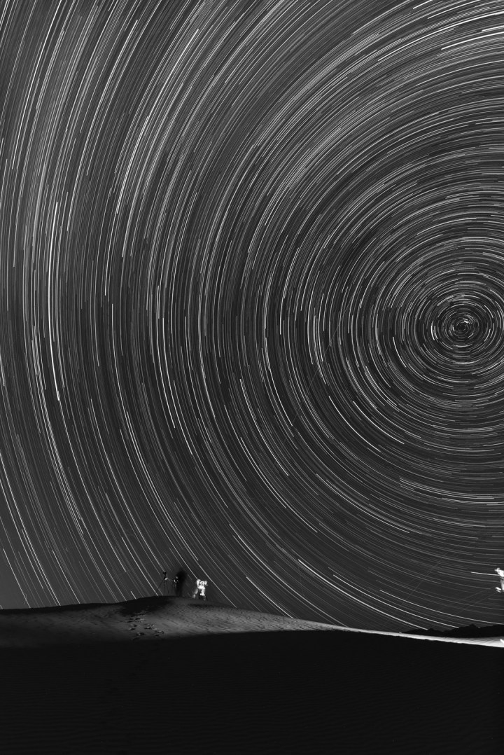 Mesquite Sand Dunes, Death Valley National Park. This image shows the stars rotating around the North Star, and faces north-northwest. Nikon D750, Nikkor 20mm f/1.8 lens. Stacked exposures totaling 2 hours, f/3.3, ISO 400.