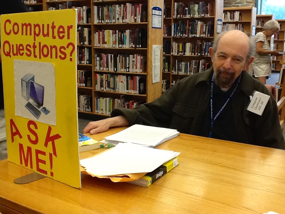 Computer Tutor Dan at Silver Spring Library of the Montgomery County Public Libraries (Maryland). Photo Courtesy of Senior Service America.