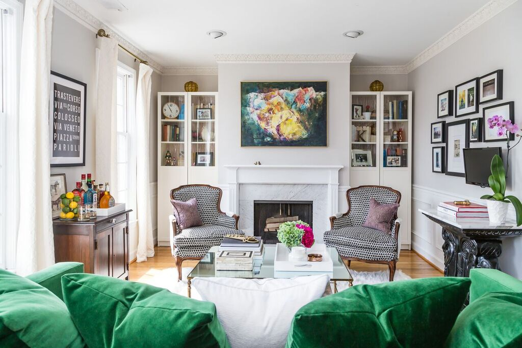 Tw Polka Dotted Chairs In Front Of Fireplace