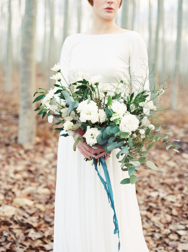 winter wedding bouquet inspiration with white and green flowers and blue accented ribbon in portland oregon