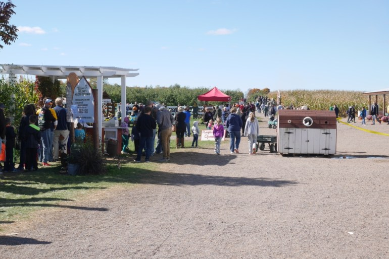 Entrance to Helene's Hilltop Orchard. Line for Activity Wristband on the left.