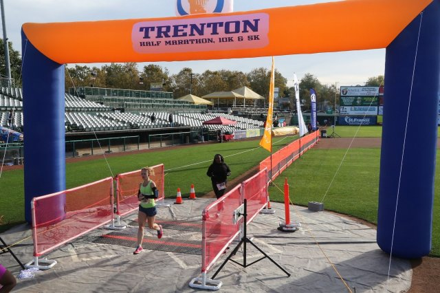 Bounding across the finish. PR! 1:39:34 Same finish line for half marathoners, 10K runners and 5K runners and walkers.
