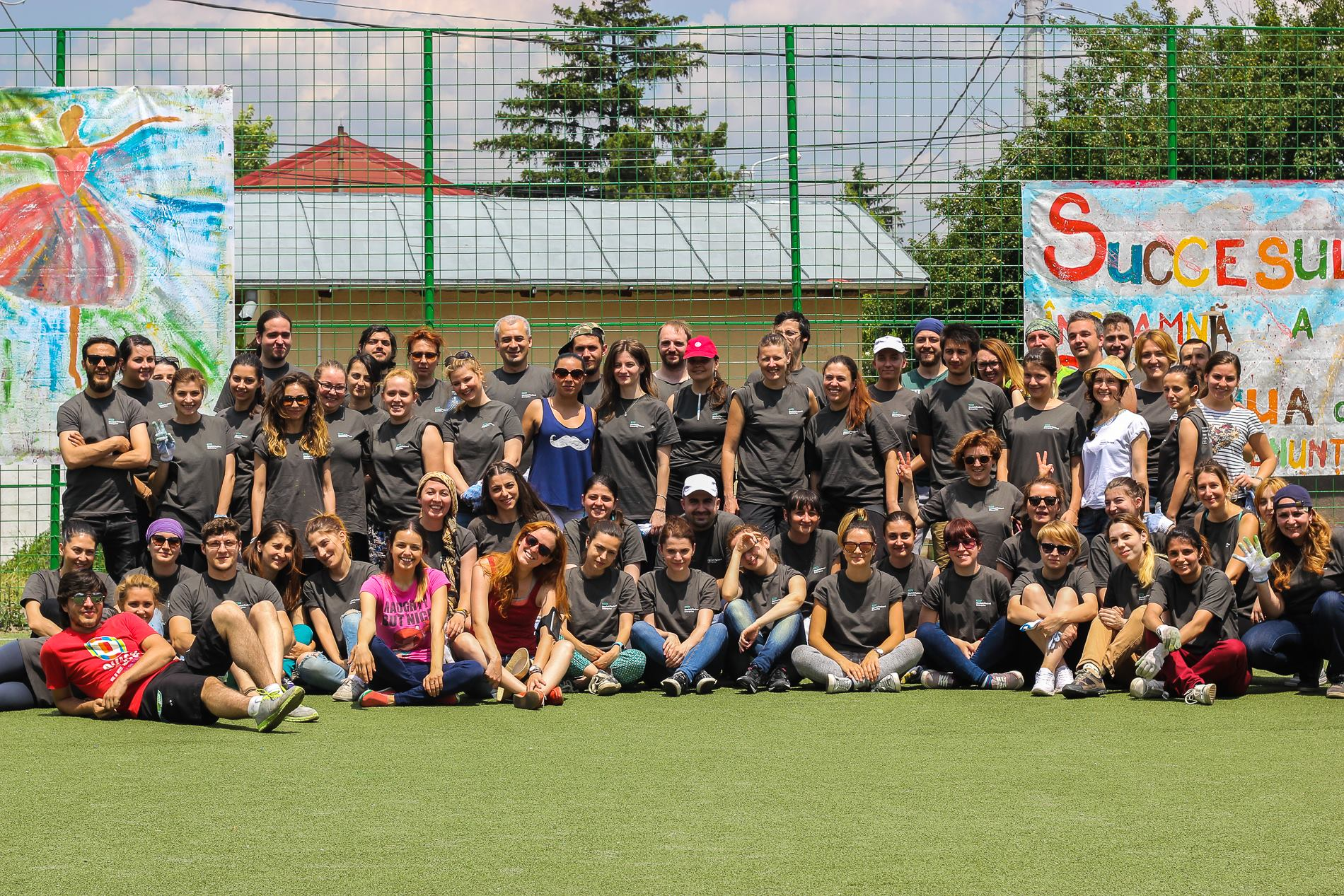 HPE employees were all smiles while volunteering at a schoolyard renovation in Bucharest, Romania