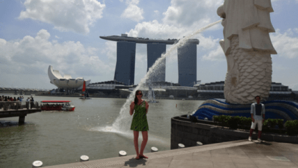 Marina Bay and the Merlion.... and a guy in white linen..... our destination in the background.