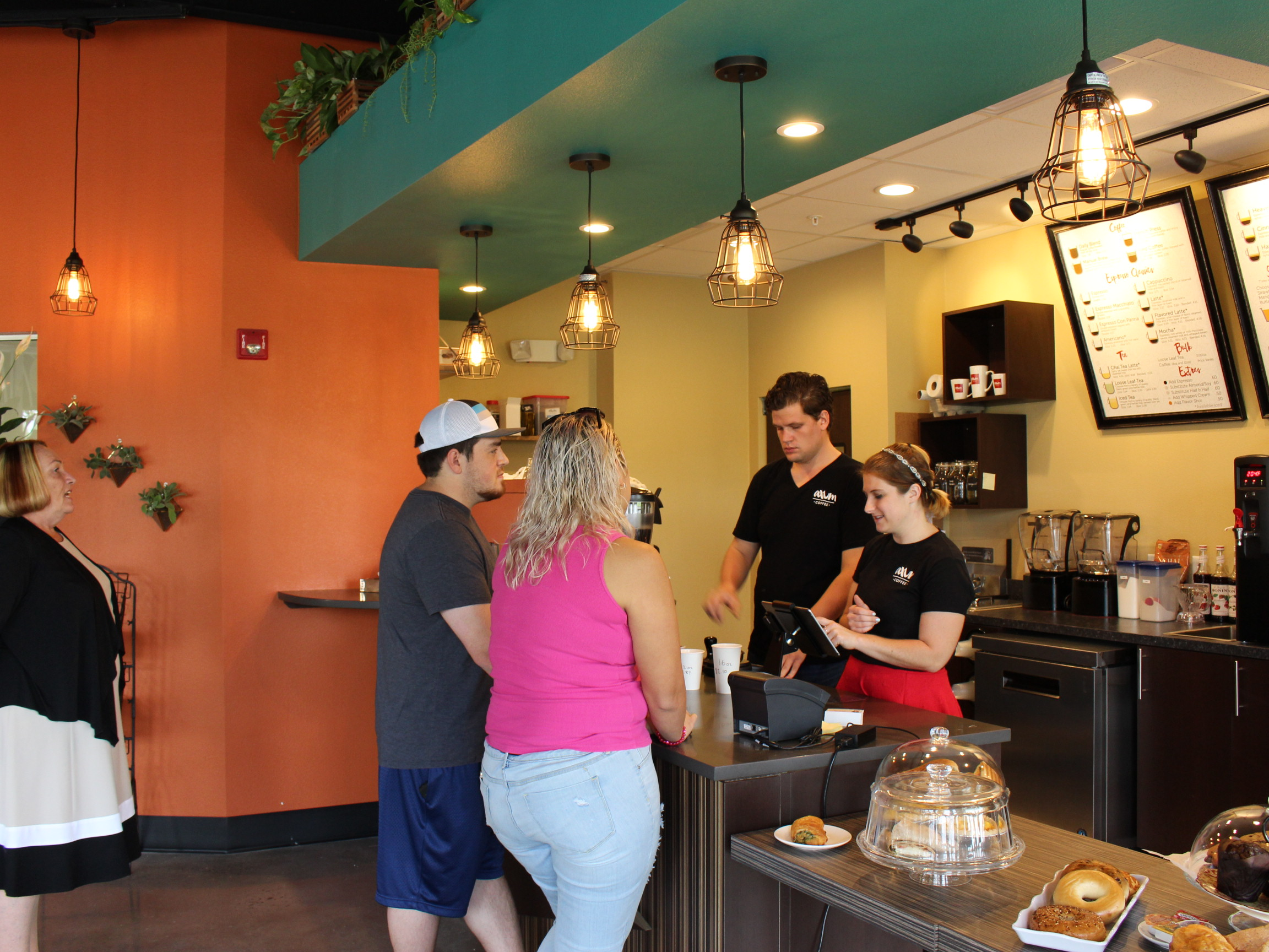 Tania Ramirez is one of the first to order Axum Coffee on opening day of the Orlando Cat Cafe. Axum Coffee and The Animal League are a part of the collaborative project to help cats find new owners.