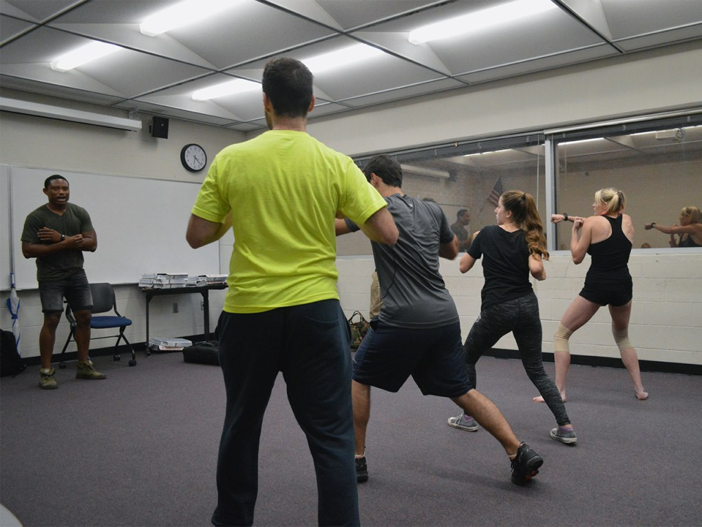 Pandit Mami, left, teaches Krav Maga, an Israeli form of self-defense, to members of Knights for Israel in UCF's Engineering I building on Wednesday, Sept. 14, 2016. Mami,originally from Sierra Leone,has taught seminars at more than 25 different schools.