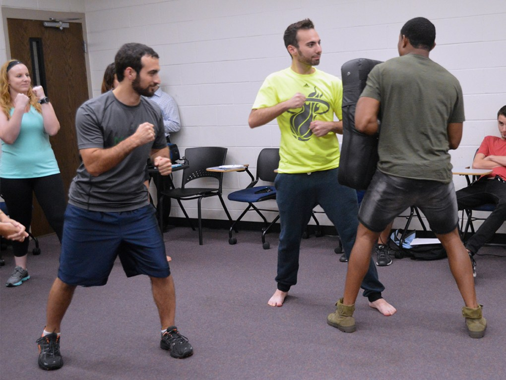 UCF senior Ben Suster, center, takes a stab at the punching method taught by instructor Pandit Mami during the Krav Maga self-defense lesson in UCF's Engineering I building on Wednesday, Sept. 14, 2016. Krav Maga is used by the Israel Defense Forces and combines boxing, wrestling and other fight training.
