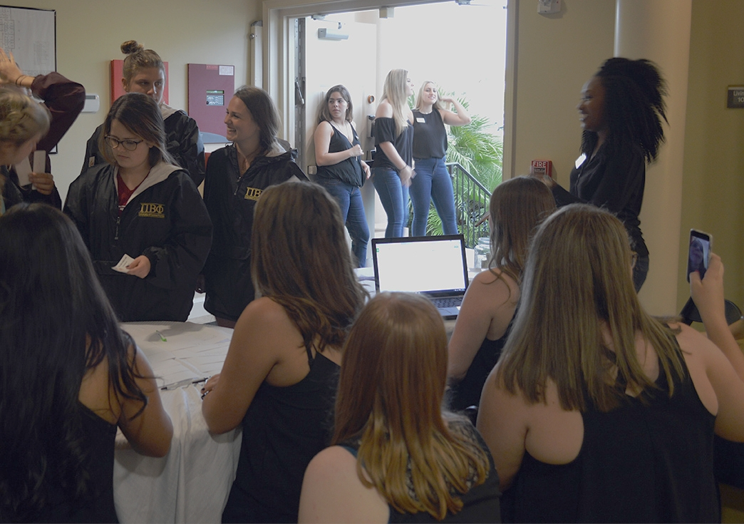 Members of Pi Beta Phi checking in at the Scoop-A-Dish for Make-A-Wish on Thursday, Sept. 15 at the Chi Omega sorority house.