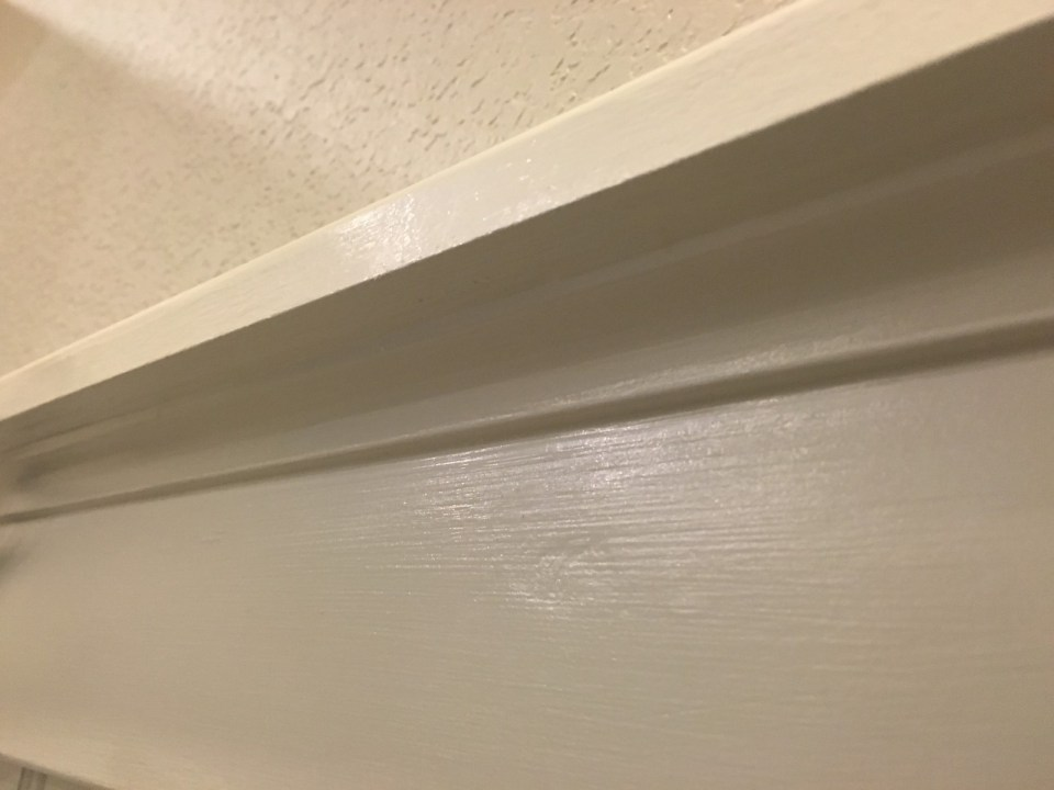 The cove molding is hard to see with the caulk and paint already done.