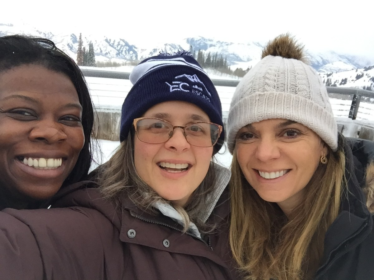 Laura Mignott, Elisa Miller-Out and Melinda Nicci grab a selfie on the ski slopes.