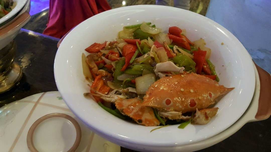 Season crab over peppers