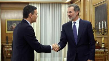 El dirigente de Podemos con el Rey Felipe VI