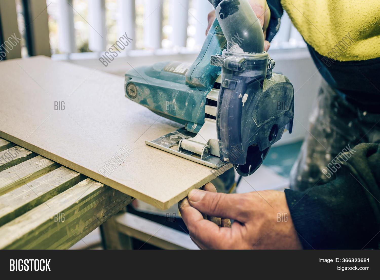 master cuts tile using image photo