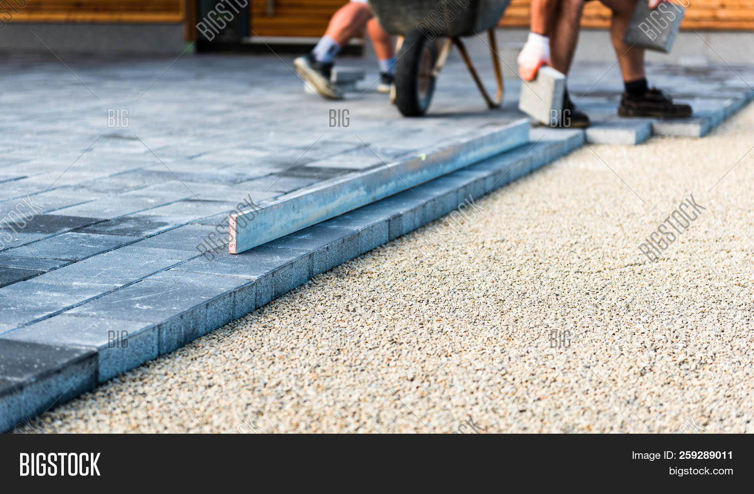 https www bigstockphoto com image 259289011 stock photo laying gray concrete paving slabs in house courtyard driveway patio