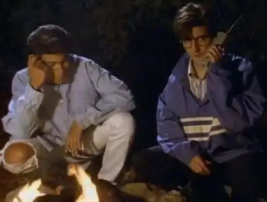 """1991-1996: The Midnight Society use a cell phone fireside in """"Are You Afraid of the Dark?"""""""